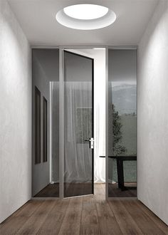 floor, walls, round skylight, door, sidelights