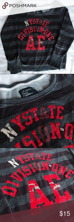 American Eagle Outfitters Sweatshirt American Eagle Outfitters sweatshirt features distressed graphics across the front (letters peeling - not a defect). Striped, cotton blend sweatshirt has only been worn a couple times. American Eagle Outfitters Jackets & Coats