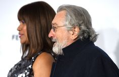 """Robert De Niro Photos - Actor Robert De Niro and his wife Grace Hightower attend the Opening Night of the 2017 Tribeca Film Festival and the world premiere of """"Clive Davis: The Soundtrack Of Our Lives"""" at Radio City Music Hall on April 19, 2017, in New York City. / AFP PHOTO / ANGELA WEISS - 'Clive Davis: The Soundtrack of Our Lives' Premiere Concert - 2017 Tribeca Film Festival"""