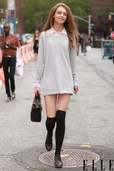 Feel like you are a university student for life in this cool combination  of: a white oxford shirt, an oversized sweater, knee-high socks, and cool Oxfords.  A+ for this outfit.