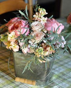 Old fashioned flowers in galvanized bucket
