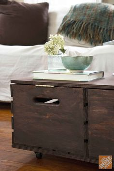 This DIY storage ottoman is made from a couple of wooden crates, some plywood and casters. It looks great and makes handy storage for your living room.