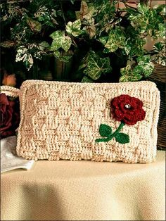 Basket Weave Clutch- Size 5 crochet cotton in a natural color gives this textured pattern a basket-weave look. Two strands of cotton and a size D/3 crochet hook are used for the gusseted purse. Skill Level: Intermediate free pdf from freepatterns.com