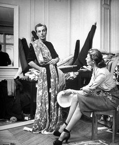 Jacques Fath and wife Geneviève discuss fabrics to determine their selections, photo by Nina Leen, Paris, February 1951