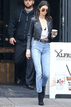 Kendall Jenner wearing Laer Cropped Moto Leather Jacket, Gucci Leather Belt with Double G Buckle, Kendall + Kylie Surplice Hi Lo Shirt and Kendall + Kylie Felicia Booties