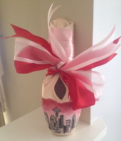 Love the way the ribbon is tied for display ------Custom Handpainted Pointe Shoes by BalletInCleveland on Etsy