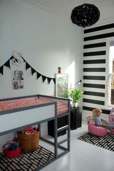 I love the black and white stripe wall because you can match anything to it! Such a fun accent.