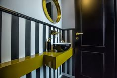 Our design concept was to create a unique space with lots of contrasts. We wanted the space to be fascinating by using a combination of warm and cold materials. We used contrasting colors like black and white, with glimpses of gold and brown.
