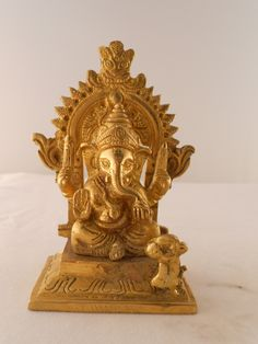 """Ganesh, the elephant headed god that removes obstacles and brings prosperity.  Hand crafted in India.  3.5"""" high."""