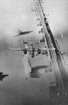 USAAF bombing over China. You can see one warhead falling free from the lead bomber....