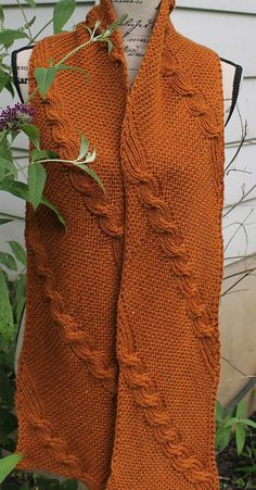 Knitting Pattern for Reversible Quixote Scarf - Garter stitch and cables knit on the diagonal formed by increasing on one side and decreasing on the other. Completely reversible. Designed by Brenda Castiel. Pictured project bygolfgirl417