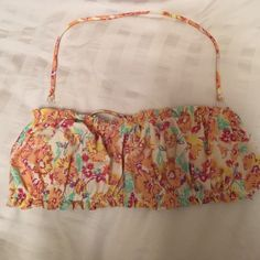 Floral swim suit top Strapless or add the detachable straps to it! Built in padding and doesn't fall off like most strapless bathing suits O'Neill Swim Bikinis