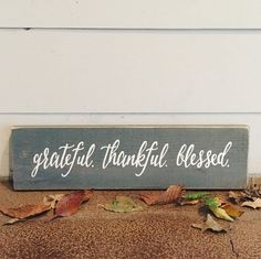 **ORDER BY DEC 15th for CHRISTMAS DELIVERY**  Grateful. Thankful. Blessed. Wood Sign   Reclaimed Wood Sign   Home Décor   Thanksgiving Décor   Holiday Decorations  PRODUCT DESCRIPTION: Grateful. Thankful. Blessed. Wood Sign. This hand painted rustic sign is the perfect Holiday décor piece :) Looks great on a fireplace mantel or on a gallery wall! The wood used to create this sign is made from reclaimed wood and has character that cant be replicated. Hooks are included for hanging. Each order…