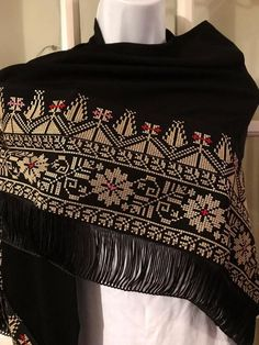 Beautiful black Shawl / puncho / poncho with detailed gold Palestinian cross stitch / embroidery.The embroidery on this shawl is machine stitched Please contact me for more details and shipping options Embroidery Tattoo, Hand Embroidery Stitches, Embroidery Jewelry, Cross Stitch Embroidery, Embroidery Patterns, Modern Cross Stitch Patterns, Cross Stitch Designs, Monogram Cross Stitch, Ukrainian Dress