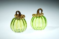 Light Green Glass Pumpkin with Gold Stem, This piece is one of our smaller pumpkins, they range in size from 3-4 inches. Some of the pumpkins we roll through a little frit on the surface, frit is small chips of glass that give the piece a little extra sparkle. This is a great fall wedding gift, Fall decor, gift for mom, gift for a friend, gift for dad, fall wedding gift, or anniversary gift, #falldecoration #glasspumpkin #blownglass #artglass #pumpkindecoration #pumpkin #giftformom Small Pumpkins, Glass Pumpkins, Winter Wedding Favors, Fall Wedding, Halloween Witch Decorations, Fall Decorations, Corning Museum Of Glass, Dollar Store Halloween, Fall Gifts