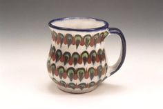 """18 oz. Green """"Peacock"""" coffee mugs are hand thrown and hand painted by a Palopo, Guatemala cooperative. They are 4.5 inches tall,  lead-free, dishwasher and microwave safe. $29.75 for 2 Mugs."""