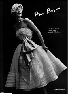 1951 Sophie Malgat in pretty strapless white organdy party dress adorned with ruffles of Valenciennes lace, by Jacques Fath
