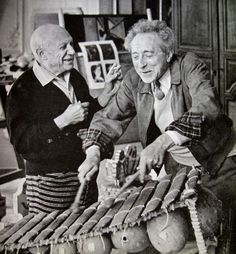 Picasso and Cocteau playing an African marimba, Cannes 1956