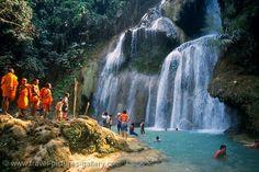 Swim in Kuang Si falls (Kuang Si, Luang Prabang, Laos). This must happen.