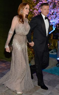 Angelina Jolie & Brad Pitt from 2014 Oscars: Party Pics. This is a much better angle of her gown.