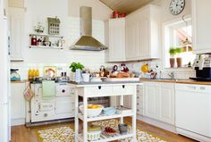 The kitchen of Eddie and Mary Lagergren in Norway.  The island looks like the $99 Ikea FÖRHÖJA kitchen cart, that has been upgraded (painted white and topped with a slab of granite.)