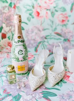 In honor of her wedding, this bride commissioned a custom-painted bottle of Champagne by Avoir Le Chic. Not only did the bottle match her ceremony and reception's springy décor, but it also featured her wedding date and monogram. Wedding Getaway Car, Modern Vintage Weddings, Gold Framed Mirror, Edible Wedding Favors, Champagne Bottles, Champagne Party, Winter Wonderland Wedding, Wedding Glasses, Green Christmas
