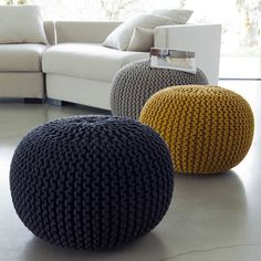 Super soft poufs made of knitted ribbon yarn. Cozy poufs for the interior. Soft furniture Super soft poufs made of knitted ribbon yarn. Cozy poufs for the interior.