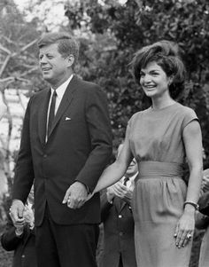 President Kennedy and the First Lady hold hands as they meet with delegates to the 1962 Conference for Democratic Women. May 22, 1962