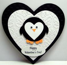 handmade Valentine card ... punch art penguin with a heart face ... black and white layered hearts for the card ... fun and cute!!
