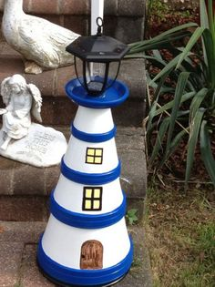 light house from clay pots Flower Pot Art, Clay Flower Pots, Flower Pot Crafts, Clay Pot Projects, Clay Pot Crafts, Diy Clay, Flower Pot People, Clay Pot People, Painted Clay Pots