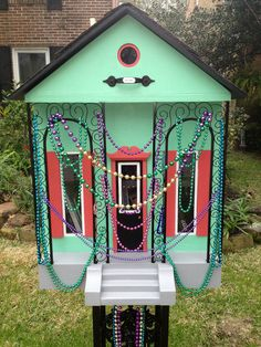 Little Free Library in Houston all decked out for Mardi Gras (Book It: How To Build a Little Library in Your Front Yard)