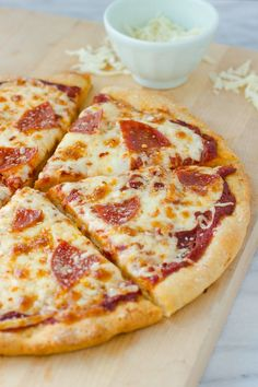 The Best Gluten-Free Pizza Crust! Easy to make and works with basically any gluten-free flour blend. Bakes up chewy and crispy!