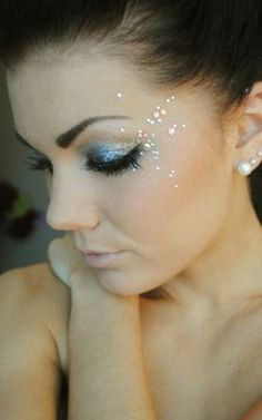 Glitter gems for reception and some gems in hair, but not over done.
