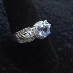 Jean Dousset - Blue Absolute Ring - size 10 Gorgeous blue Absolute CZ stone, surrounded by clear Absolutes on this Sterling Silver (stamped 925) ring by Jean Dousset for HSN. Size 10. Beautiful! Jean Dousset Jewelry Rings