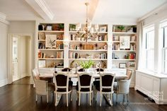 Classic dining room with built in bookshelves. Love the display.