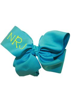 "This personalized large turquoise hair bow is made of 3"" grosgrain ribbon to give you the fullest effect. It is a popular gift among young tweens and teens and even high school kids! Turnaround time is 3 business days plus shipping time. For customization please email Stylist@shoptiques.com with your choice of heat press color, monogram style and monogram initials. All custom items are final sale.     Measures: 7"" - 8"" across   Personalized Turquoise Bow by Party Cat. Accessories Austin…"