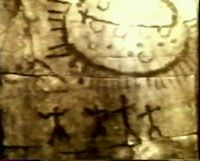 5,000 B.C. This picture is a 7000 year old petroglyph discovered in the province of Querato, Mexico in 1966. You can see 4 figures with their arms outstretched below a large oval object radiating what appear to be beams of light. UFO's and Aliens in Art History
