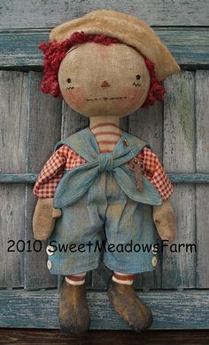 This is the PATTERN to make both of these old and antique looking dolls as pictured. Pattern includes both boy and girl dolls and their clothing. They will make up to 12 long each. They have squatty bodies, fat legs, and big, round heads. I had so much fun creating these dolls and