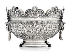 A Victorian period sterling silver monteith, with cherub motif around the rim and lion motif at the handles -  by Walter & John Barnard, London, c1894