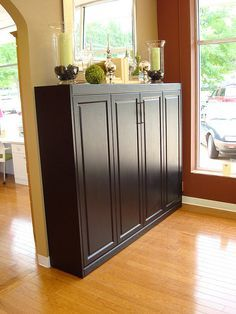 Apparently its a Murphy bed, but I like it as a tall shelf/cabinet space - Decoration for House Murphy Bed Ikea, Murphy Bed Plans, Camas Murphy, Tall Shelves, Modern Murphy Beds, Sweet Home, Muebles Living, Bed Photos, Hidden Bed