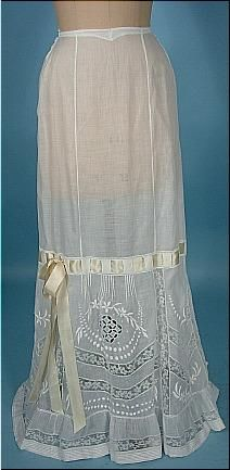 c. 1910 White Batiste Cotton Fancy Lace Slip with Embroidery. Embroidered flowers with lace inserts, ruffled hem. slight train. More photos at link.