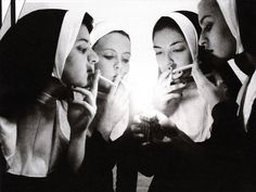Smoking Nuns. Anybody know how the photografer is?!