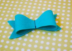 Here's a fun and free tutorial that will allow you to make cute felt bows.