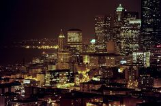 Smith Tower and a hill of skyscrapers, rainy night city: S…   Flickr