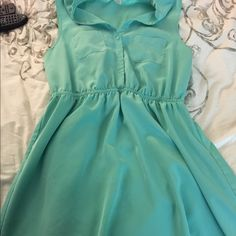 Mint color light summer dress-RESERVED Very cute and girly summer dress. It is mint in color, elastic around the waist. A very light almost silky material. It's a XL but it feels more like a L on. It goes to my mid thigh and I'm 5'5 one clothing Dresses