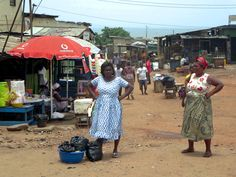 Ga women posing on a street corner in Jamestown at Accra, Ghana. Capital Of Ghana, Accra, Female Poses, West Africa, Corner, African, Street, People, Women
