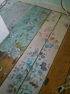 Painted decoupaged floor boards for a cottage