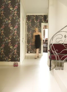 white lobby with black floral wallpaper designed by Fornasetti, cole and son fornasetti, cole&son fornasetti fiori, hall, stylish stairs
