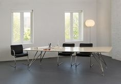 With innovative details and materials that impart a lighter scale and a clean modern appeal, A Frame is perfect for any interior whether in a conference room setting  or private office. The graceful and lean legs form the shape of an A as they emerge from the table top.  The  streamlined profile follows the aesthetics of absolute minimalism while  providing  visual interest from almost every angle. Design: Aaron Duke