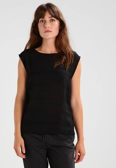 """Minimum. JENSINE - Blouse - black. Fit:regular. Outer fabric material:100% polyester. Our model's height:Our model is 69.0 """" tall and is wearing size 8. Pattern:plain. Care instructions:do not tumble dry,machine wash at 30°C,Machine..."""